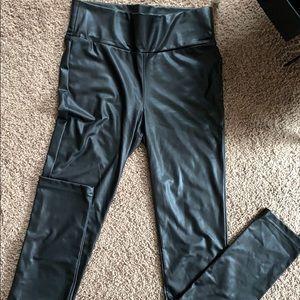 Like new! Black wet look/faux leather leggings.